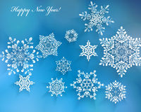Blue Winter Background with Snowflakes Stock Photos