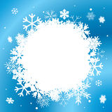 Blue winter vector background with white snowflakes Stock Images