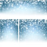 Blue winter backgrounds with snowflakes. Blue shiny winter backgrounds set with white snowflakes. Vector illustration Stock Photos