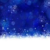 Blue winter, Christmas background with snowflakes, stars and shiny lights