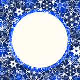 Blue winter frame with ornate snowflakes. Beautiful blue winter frame with white stylized snowflakes. New Year and Christmas festive card with place for text Stock Photos