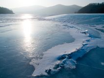 Blue winter ice lake. Against the sunset Royalty Free Stock Photography