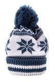 Blue winter knitted ski hat isolated on white background vertical Royalty Free Stock Photography