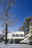 Blue winter sky after blizzard. The house covered in deep snow after snow storm Royalty Free Stock Photos