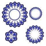 Blue winter snowflakes. Set of circular ornaments with blue winter snowflakes Stock Photos