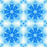 Blue winter tile with a flower or mandala design Stock Images