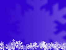 Blue wintry background. An abstract blue, wintry background with a border at the bottom representing white snowflakes Stock Images