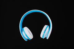 Blue wireless headphones isolated on black Stock Images