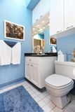 Blue wnad white small bathroom sink and toilet. Royalty Free Stock Photos