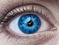 Blue woman eye with clock. Concept photo Stock Photo