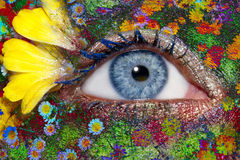 Blue woman eye makeup spring flowers metaphor. Blue woman eye makeup inspired in spring with flowers meadow and yellow petals Royalty Free Stock Photos