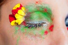 Blue woman eye makeup spring flowers metaphor Stock Image