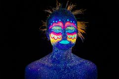 Blue woman portrait, aliens sleeps, ultraviolet make-up. Beautiful on a dark background. Full face portrait. Horizontal stock photo