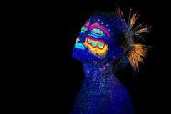 Blue woman portrait, aliens sleeps, ultraviolet make-up. Beautiful on a dark background. Head up stock photo