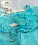 Blue woman's knitted blouse with decoration flower Stock Photo