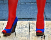 Blue women's shoes and red socks. Blue woman's shoes on platform and red socks Royalty Free Stock Photography