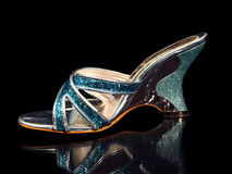 Blue woman shoe isolated on black background stock photography