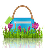 Blue woman spring bag with crocuses flowers and sale label in gr Royalty Free Stock Photos