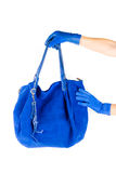 Blue women bag at hand Royalty Free Stock Photography