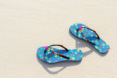 Blue women`s beach shoes, with white sand, blue sea and sky. Thailand, Similan Islands. Royalty Free Stock Photo