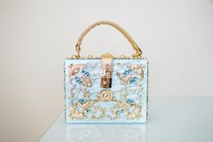 Blue women`s handbag with gold handle stock photos