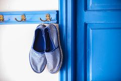 Blue women's slippers in Greek style of house on Stock Photo