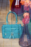 Blue womens handbag on the floor Stock Image