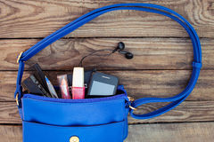 Blue womens purse. Things from open lady handbag Royalty Free Stock Photos