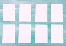 Blue wood background and white blank note papers. Note Paper Concept and Decoration Stock Image