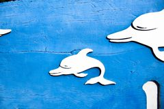 Blue wood carving. Whale hole, background stock images