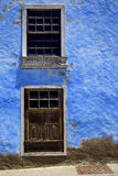 Blue wood   couple of window in a paint wall arrecife lanzarote Royalty Free Stock Photo