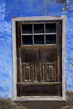 Blue wood  distorted window in a paint wall Stock Photography
