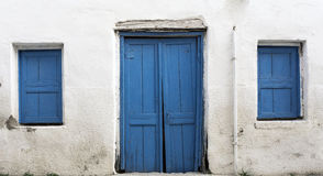 Blue Wood Door. Blue Window and Door on Stone Wall Royalty Free Stock Photo