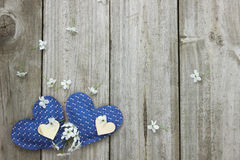 Blue and wood hearts with spring blossoms border wooden fence royalty free stock image