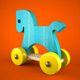 Blue wood horse on red background (symbol of the new year 2014). 3d Stock Images