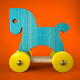 Blue wood horse toy on red background. 3D Stock Image