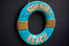 Blue Wood Sun Surf Beach Sign Summer Colorful Rope stock photo