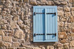 Blue wood window at old rustic wall. As background royalty free stock images
