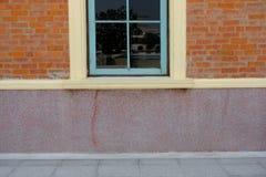 Blue wood window & orange brick wall. Blue wood window and orange brick wall stock photos