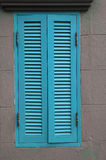 Blue wood window on wall Royalty Free Stock Images