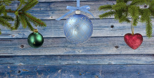 Blue wooden background with Christmas symbols around. Christmas, New Year card with copy space in the center Stock Images