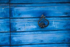 Blue wooden background. Blue wooden door with a handle Stock Image