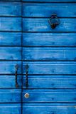 Blue wooden background. Blue wooden door with a handle Stock Photos