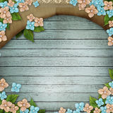 Blue wooden background with  flowers Royalty Free Stock Photo