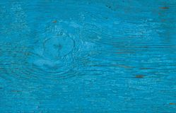 Blue wooden background. Painted wood board surface with cracks. stock photography