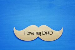 Blue wooden background and paper mustache. fathers day concept Stock Photos