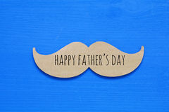 Blue wooden background and paper mustache. fathers day concept Royalty Free Stock Photography