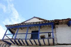 Blue wooden balcony of an old colonial house Royalty Free Stock Image