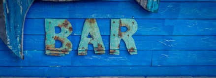 Blue wooden bar sign Royalty Free Stock Image