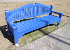 Blue wooden bench. Near path, Lithuania royalty free stock images